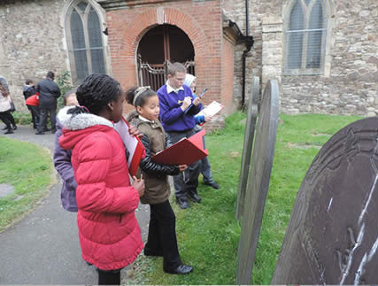 Photo of children visiting a cemetery